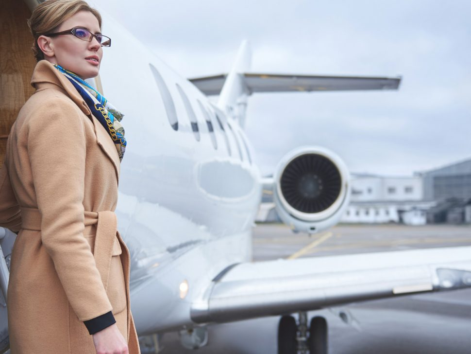 Woman With Glasses Exits From Private Jet Door