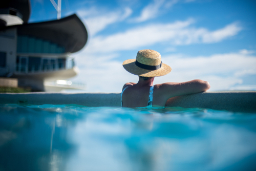 Woman With Straw Hat In Pool
