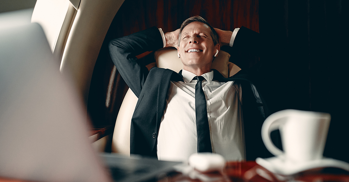 Happy Man Relaxes On Private Jet