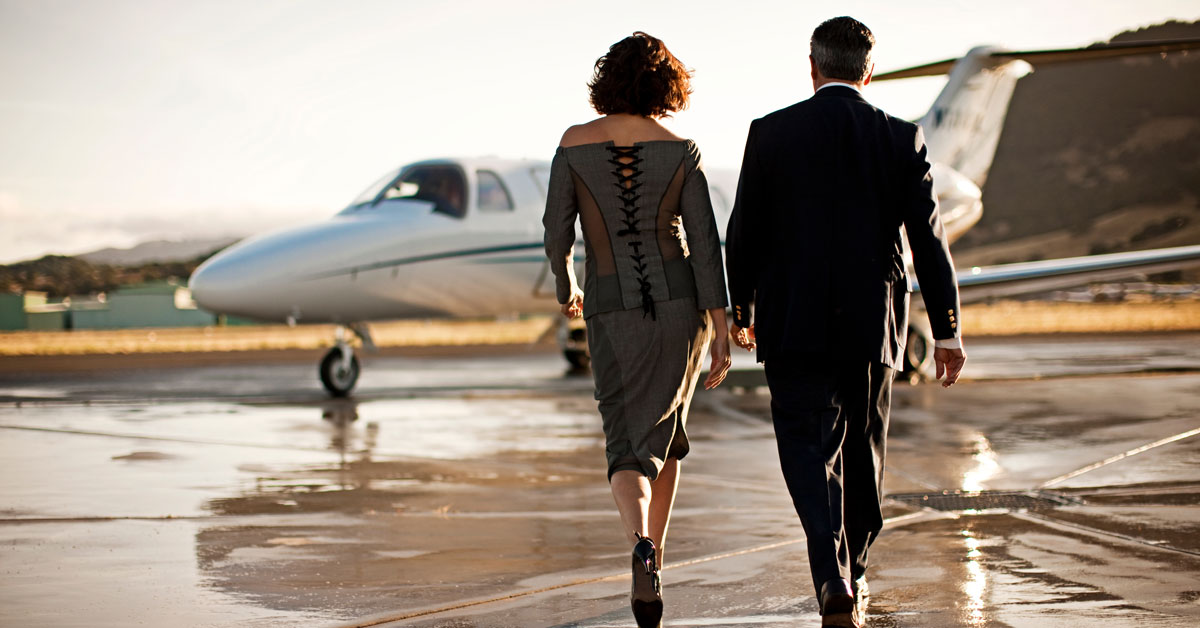 well dressed couple private jet