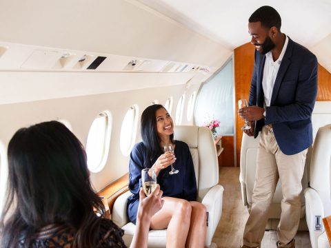 well dressed people flying private jet